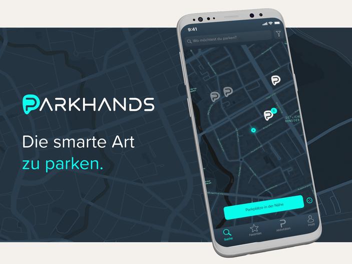 """Die Darstellung der App für Parkhands. Auf einem Smartphone ist eine dunkelblaue Stadtkarte mit Buchstaben """"P"""" abgebildet."""